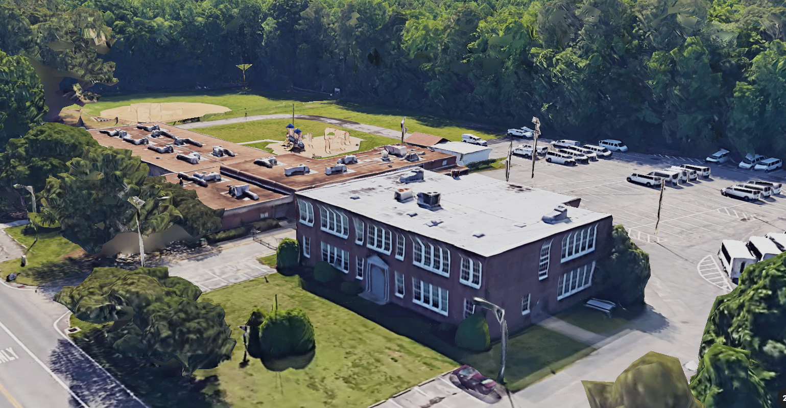 An angled overhead view of the former Court House Elementary School complex.