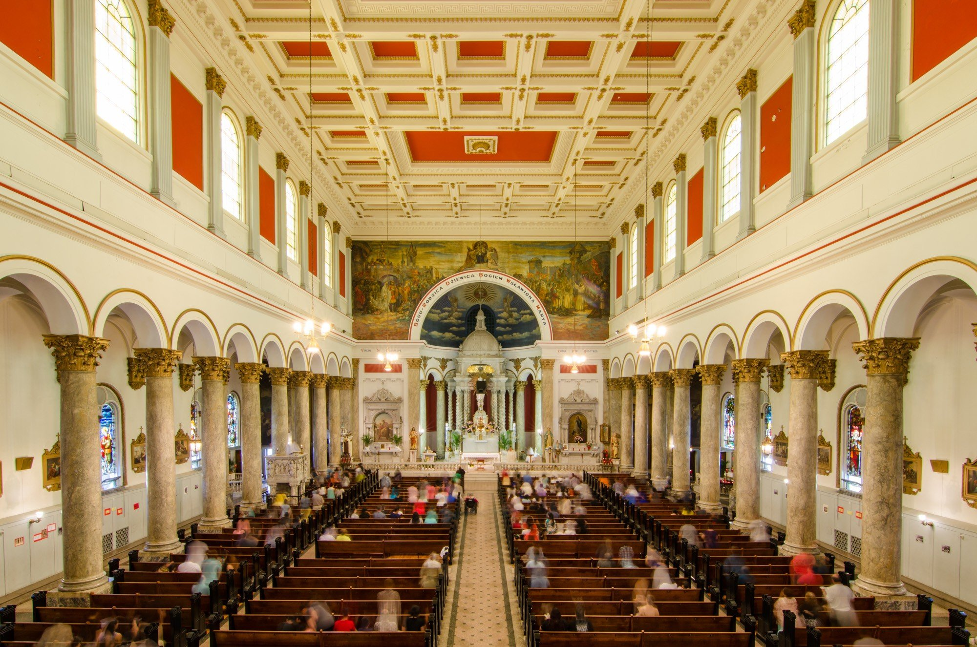 Each side of the church's interior is framed by 12 marble columns. At the front and center of the church stands a statue of Our Lady of Częstochowa, the Polish Virgin Mary.
