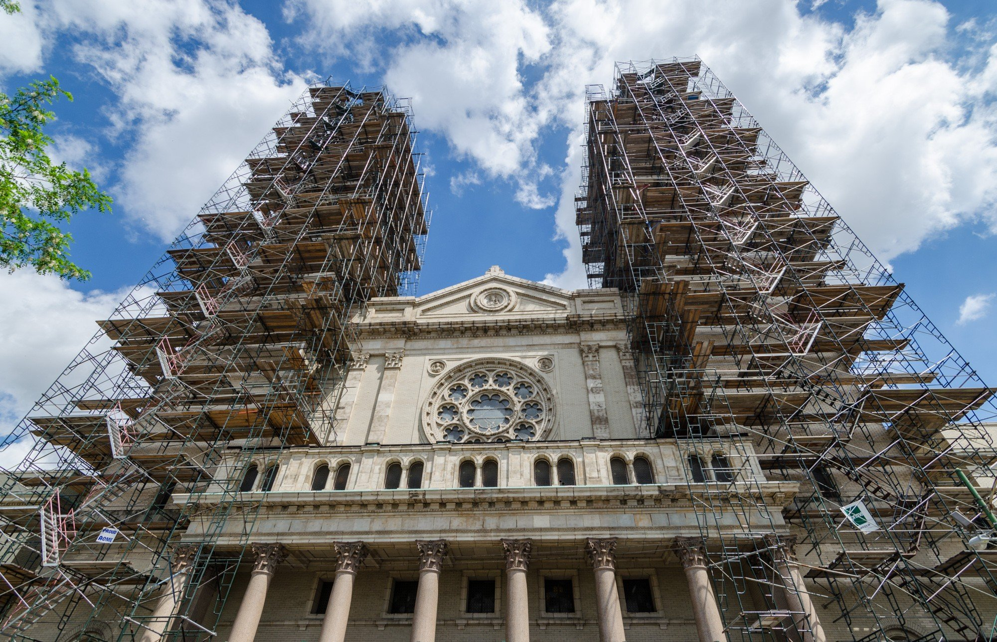 Scaffolds surround each of the two 185-foot bell towers, which allegedly resemble the two Baroque towers of the Basilica of San Juan de Los Lagos in Mexico. 