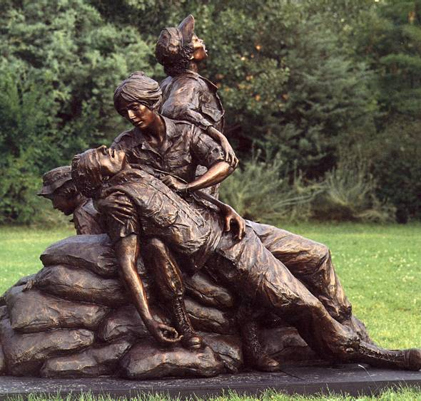 """The Vietnam Women's Memorial depicts nurses caring for an injured solider.  Sculptor Glenna Goodacre wrote, """"Even though he is wounded, he will live. I want this to be a monument for the living."""" Wikimedia Commons."""