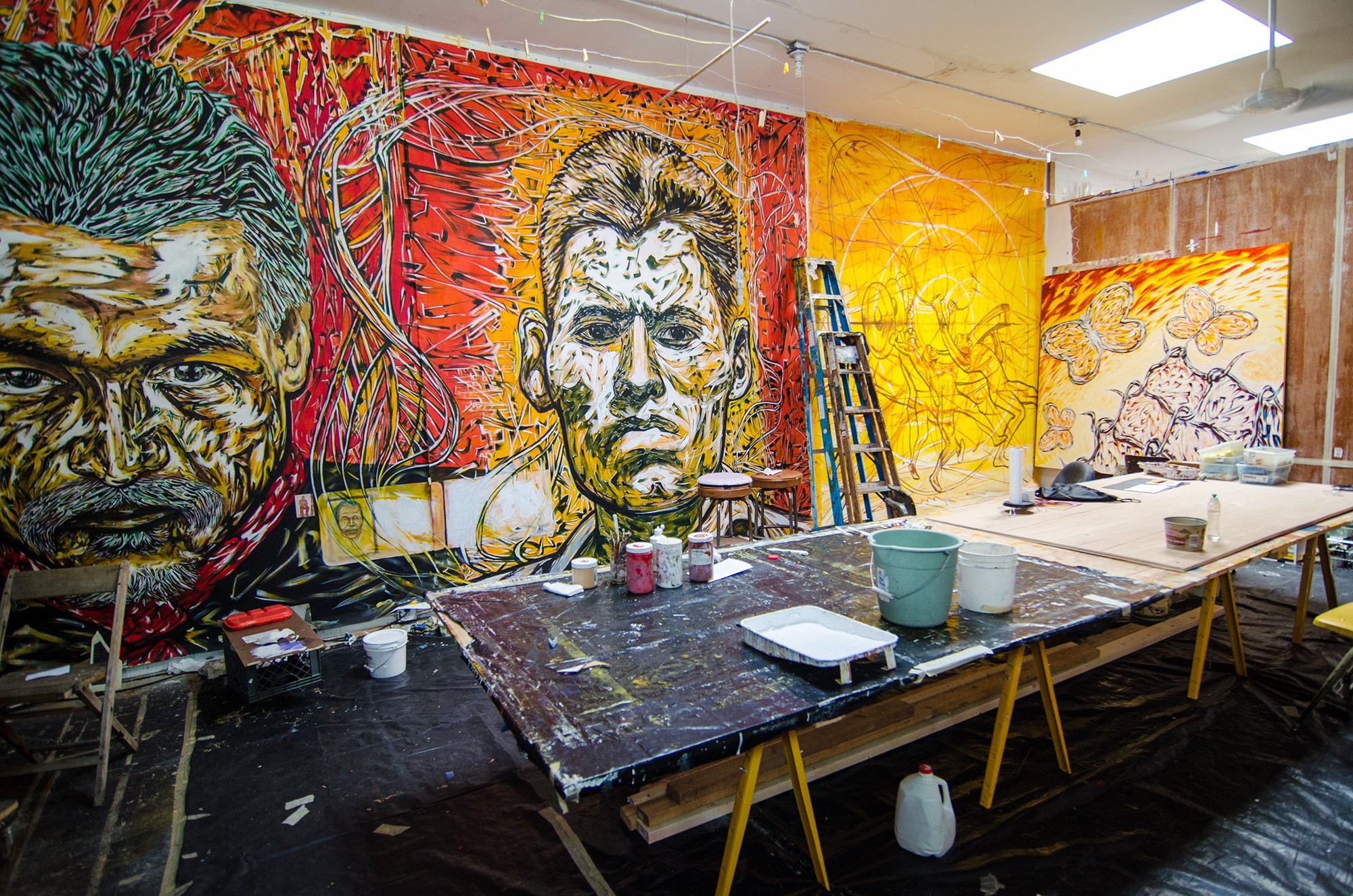 Inside his studio, Hector Duarte paints and stores some of his works of art (courtesy of Eric Allix Rogers).