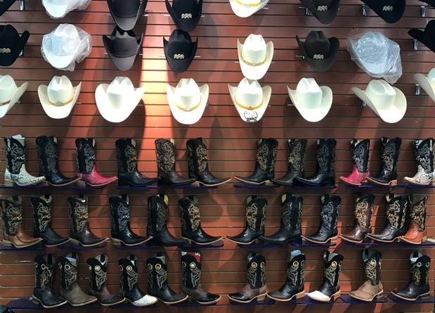 Traditional clothing like boots and cowboy hats, an ode to the Southwest, can be found at many stores in the discount mall. Source: Ahrensdorf, Lucia. Little Village. South Side Weekly. October 01, 2014. Accessed May 30, 2019. https://southsideweekly