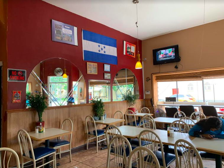 The inside of the restaurant has a quaint feel and is decorated with Honduran souvenirs and flags.