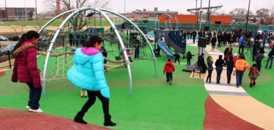 This photo taken on opening day shows that the park forms relationships between children, parents, and whole families. The park provides the opportunity for community building as if giving back to the community that created it.