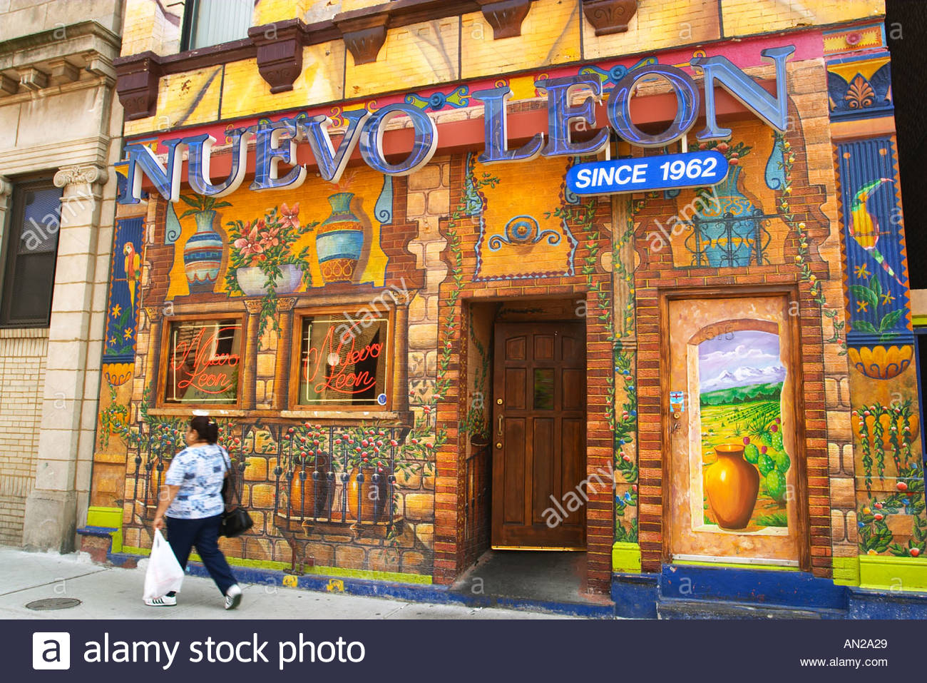"""Street Scene Chicago Illinois Pilsen ethnic Hispanic neighborhood Nuevo Leon restaurant mural on building"" by Kim Karpeles/Alamy Stock Photo. 17 x 11.3 inches. 27 May 2003. Retrieved May 28th, 2019."