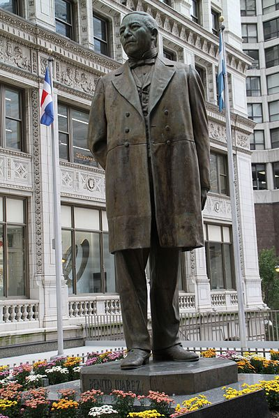 The current statue of Benito Juarez that was introduced in 1999, which stands in the Plaza of the Americas. The statue is 16 feet tall and was sculpted by Julian Martinez. 
