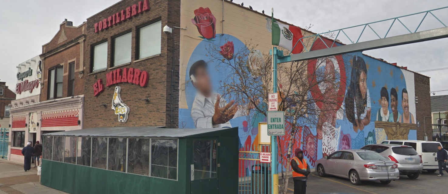 The bright mural art stands out on the side of the building.
