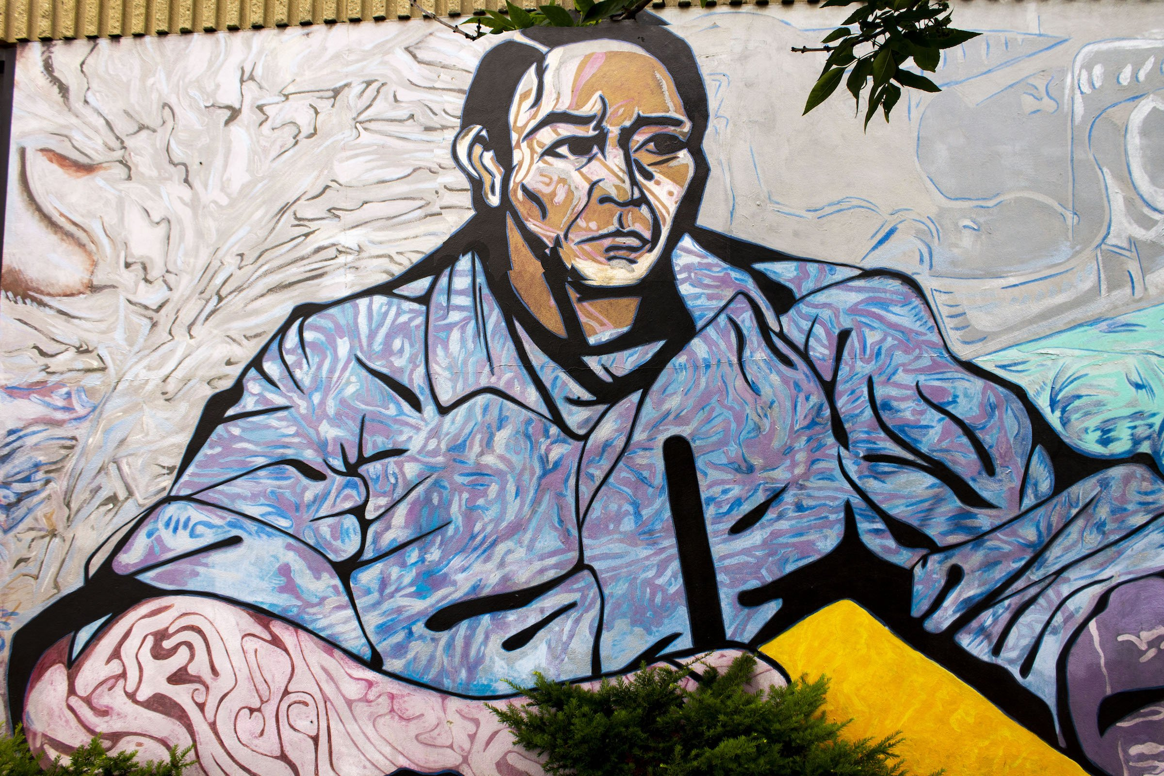 At the beginning of the mural Benito Pablo Juárez García is shown writing on a paper. He is displayed as strong, powerful and successful all attributes the community of Pilsen wanted to instill and inspire its youth with.
