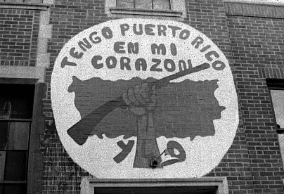 "A mural outside the People's Church reading ""I have Puerto Rico in my heart"" with the group's acronym beneath. Many murals outside the church, including this one, were painted by then 20-year-old activist Felícitas Nuñez of California."