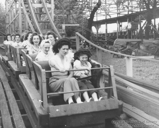 Photo of park attendees riding the Jack Rabbit in the early 1900s.