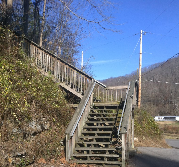 The steps, near Betty McCoy's home, which lead up to Sally's grave