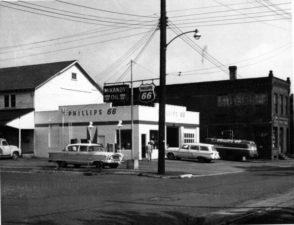 fNorthwest corner of Prospect & Mechanic in the 1950s, showing the feed mill on the left, Tanner's Cheese House on right, McKandy's Oil.