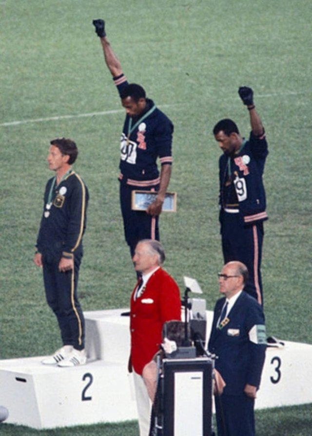 John Carlos, Tommie Smith & Peter Norman during the 1968 Olympic Ceromonies