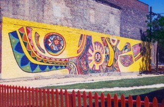 """Peace"" was painted by Mario Castillo in 1968 and the first Mexican mural in Pilsen"