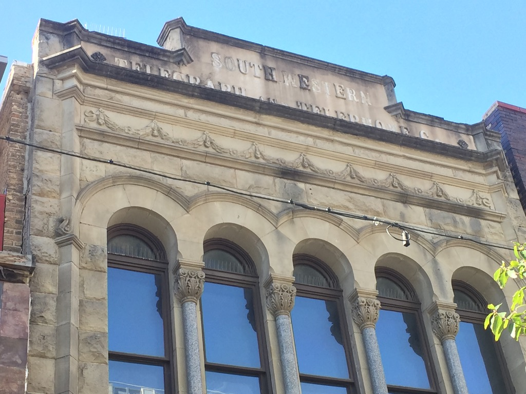The Southwest Telegraph and Telephone Company Building name can still be seen on the top of the historical building.