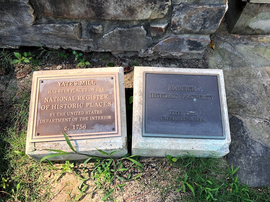 Raleigh Historic Property and National Register of Historic Place Plaques.
