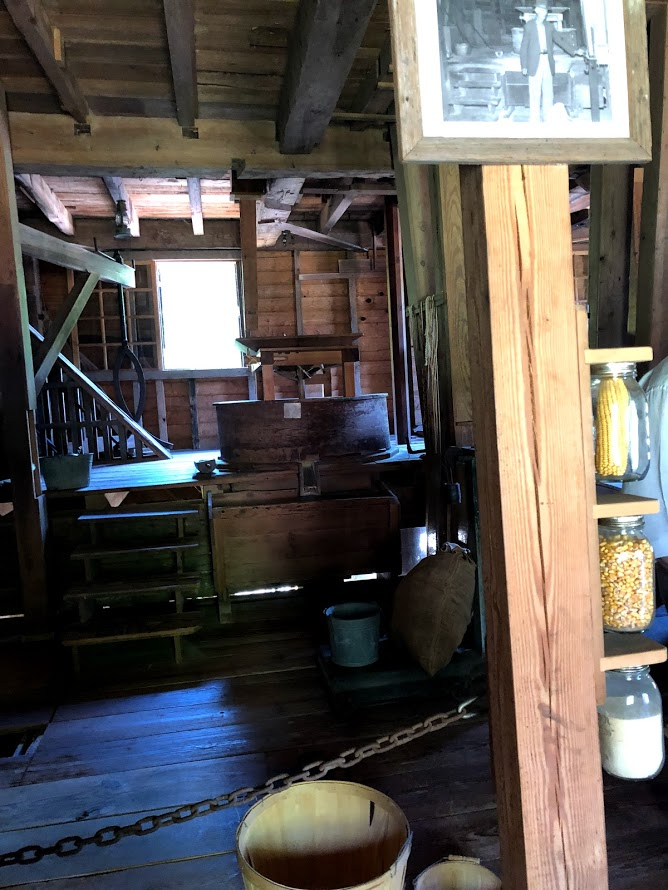 Inside of the mill with examples of the different steps to corn milling on the right.