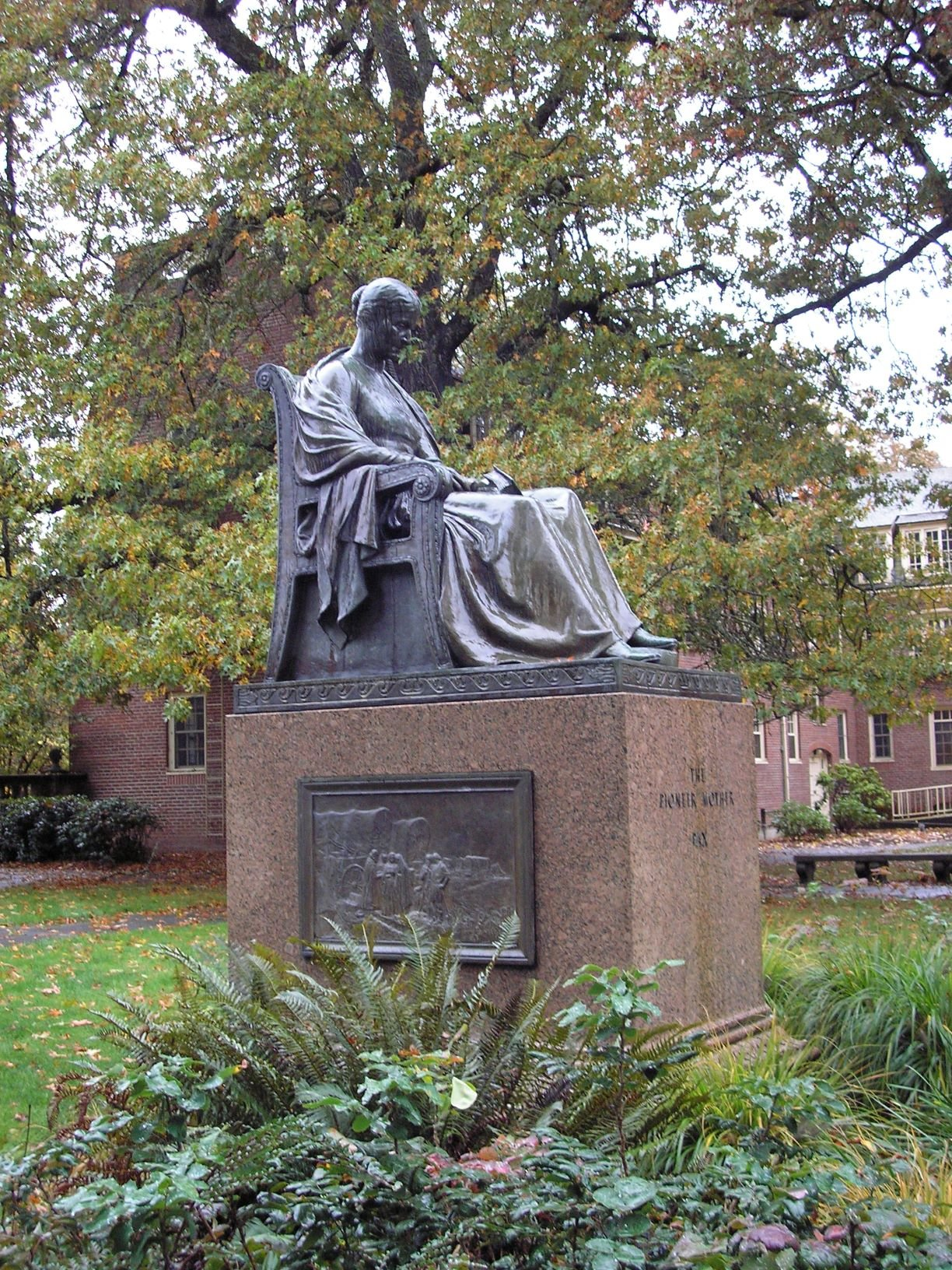Pioneer Mother statue side view with bas relief