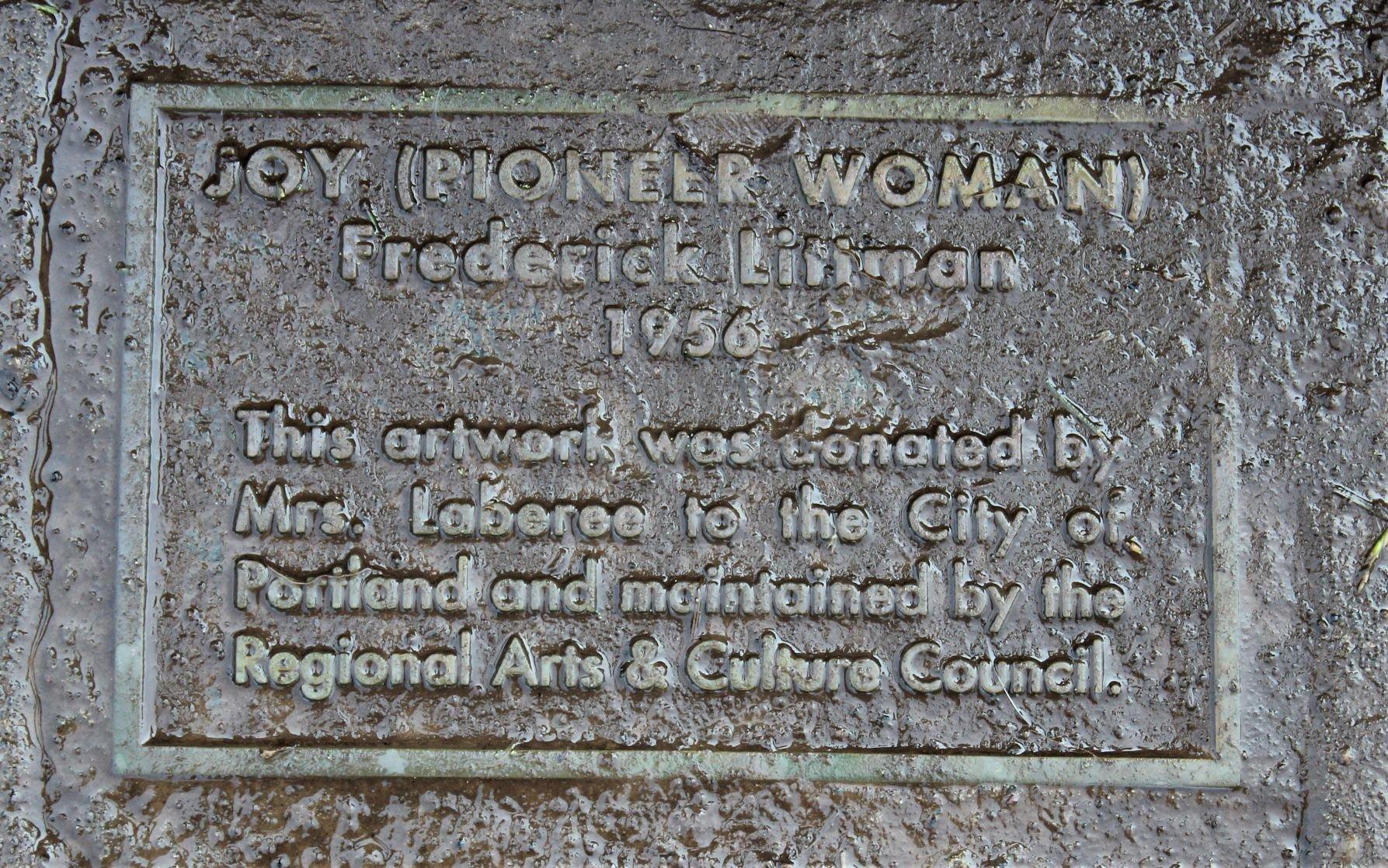 Joy (Pioneer Woman) plaque at base of fountain. Photo by Cynthia Prescott.