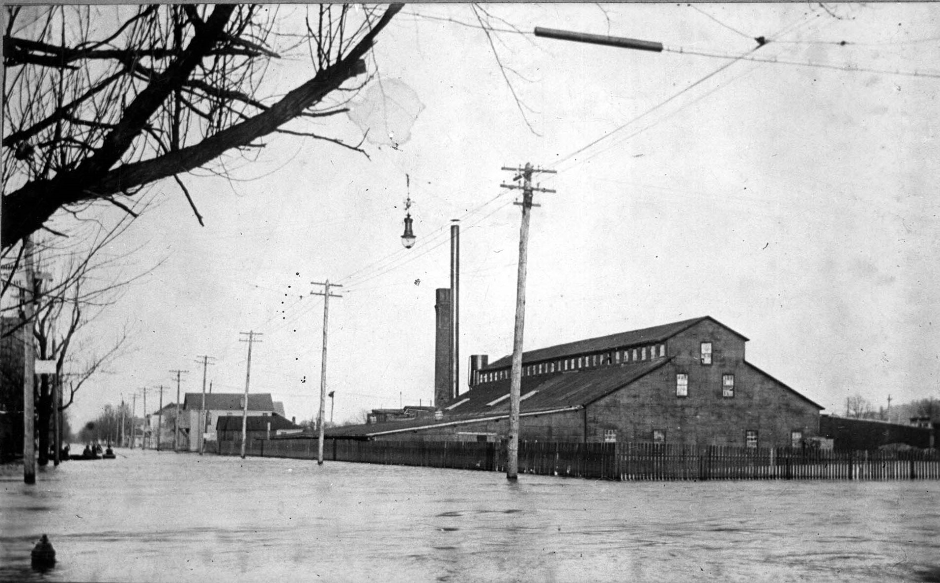 The only known photograph of the Hartzell Handle factory, seen here in the Flood of 1913. Image courtesy of Marshall University Special Collections.