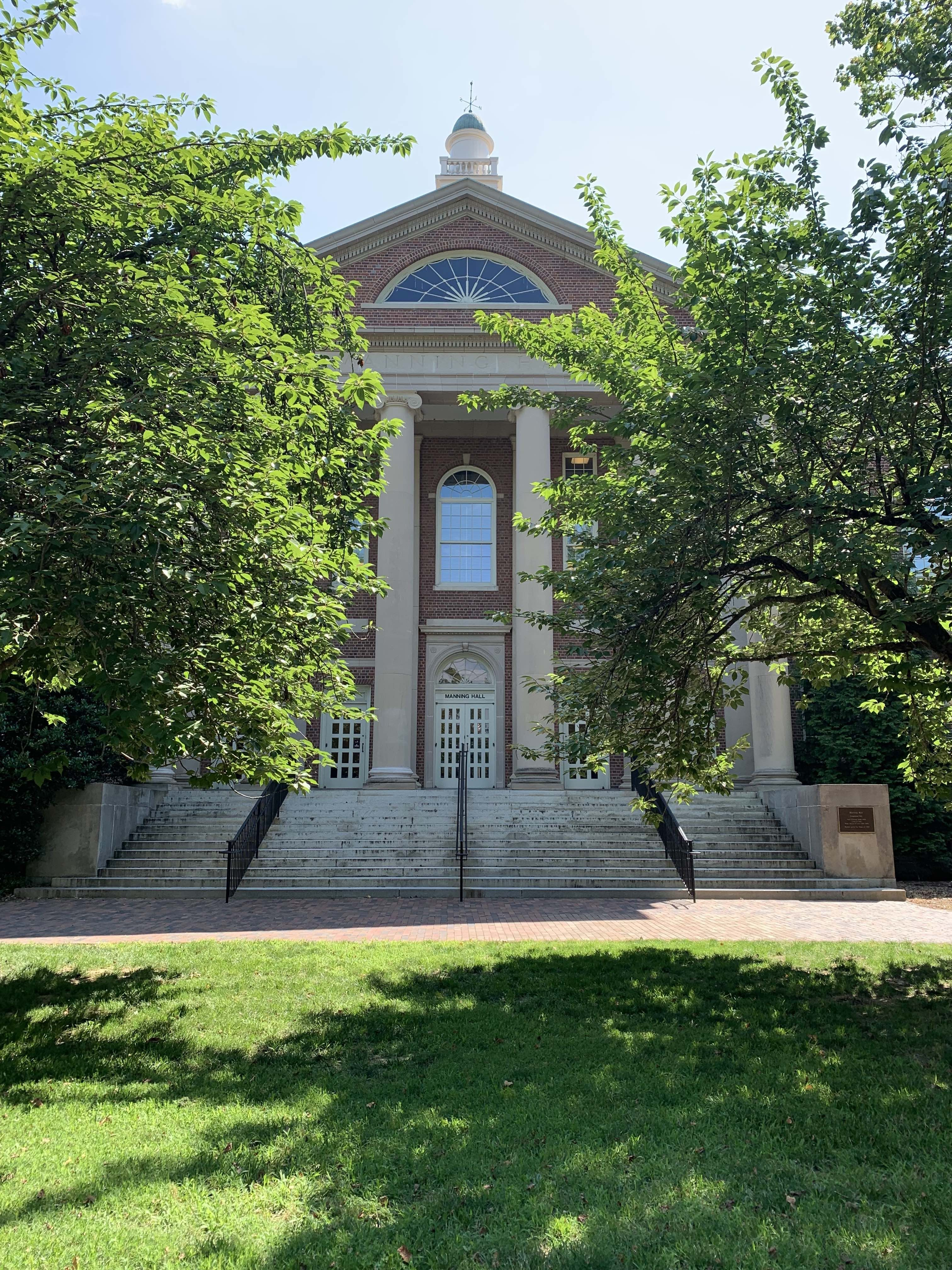 The front view of Manning Hall from the quad between Carolina and Murphy Halls.