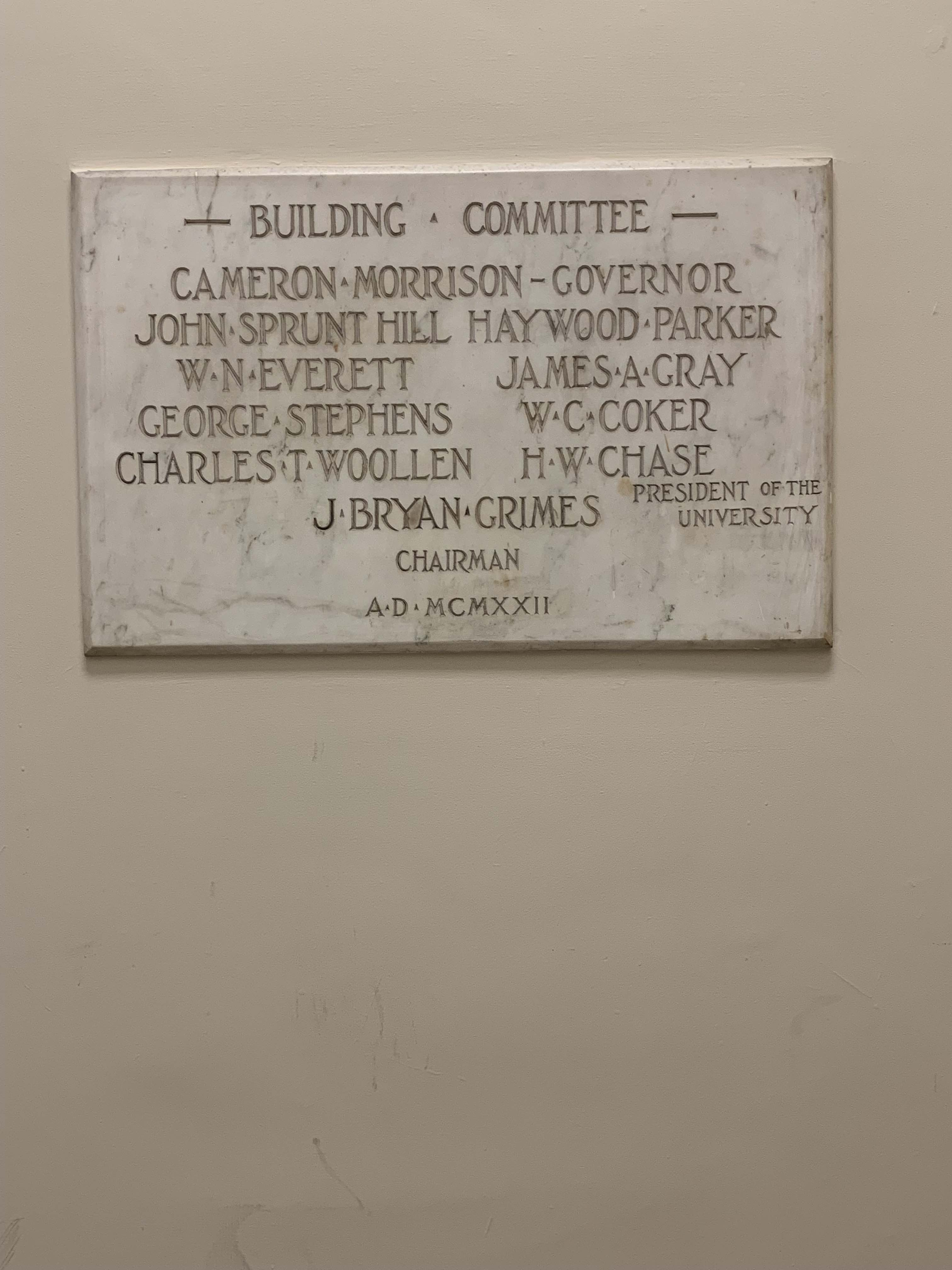 On this building committee plaque just inside Manning Hall's front doors are a few notable individuals. Both W. C. Coker and Charles T. Woollen also lent their names to buildings across UNC's campus.