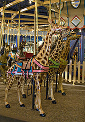 A row of giraffes was always part of one of Dentzel's carousels, as they were his favorite animal.