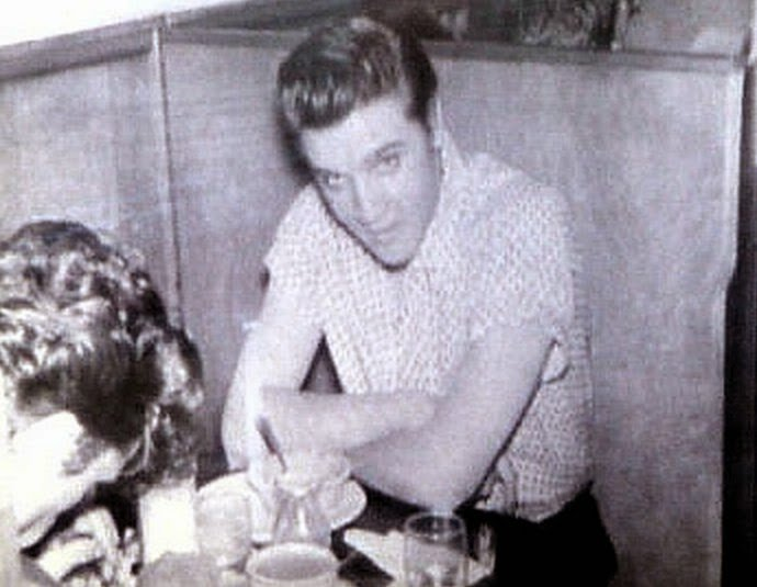 The photo of Elvis sitting in the famous Elvis Booth, taken by Paul Cramer in 1956