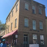 This is a picture of the original Montmollin Building. The middle window of the top floor is said to be where the actual auction block was located and the two side windows are where the women would change their clothes to be sold into the slave trade.
