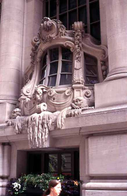 Detail of the Yacht Club's windows, inspired by galleons and with seaweed dripping over the edge