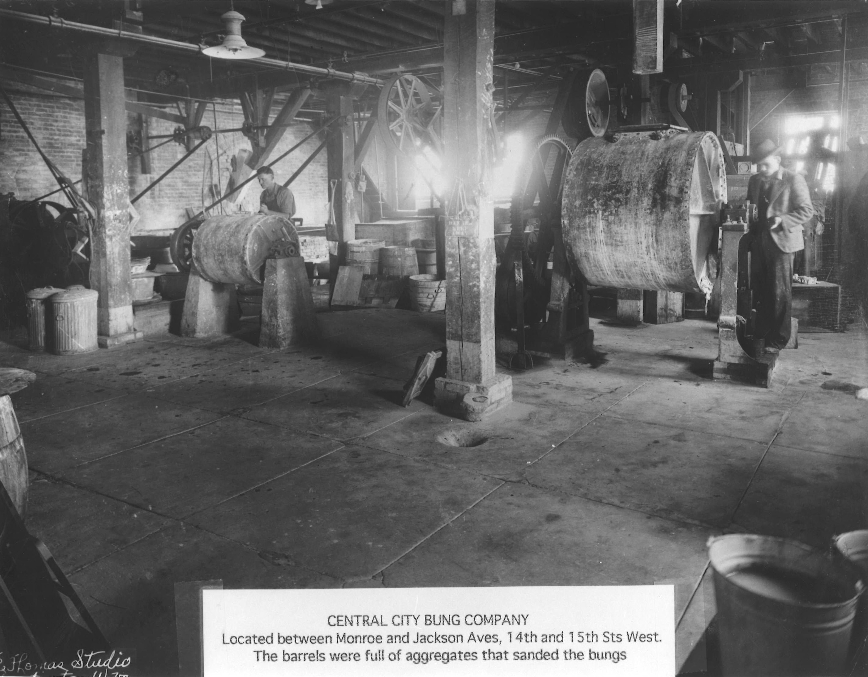 Workers inside the factory. Specialized machines were used for producing the bungs, and they reportedly were closely guarded. Image courtesy of the West Huntington Public Library.