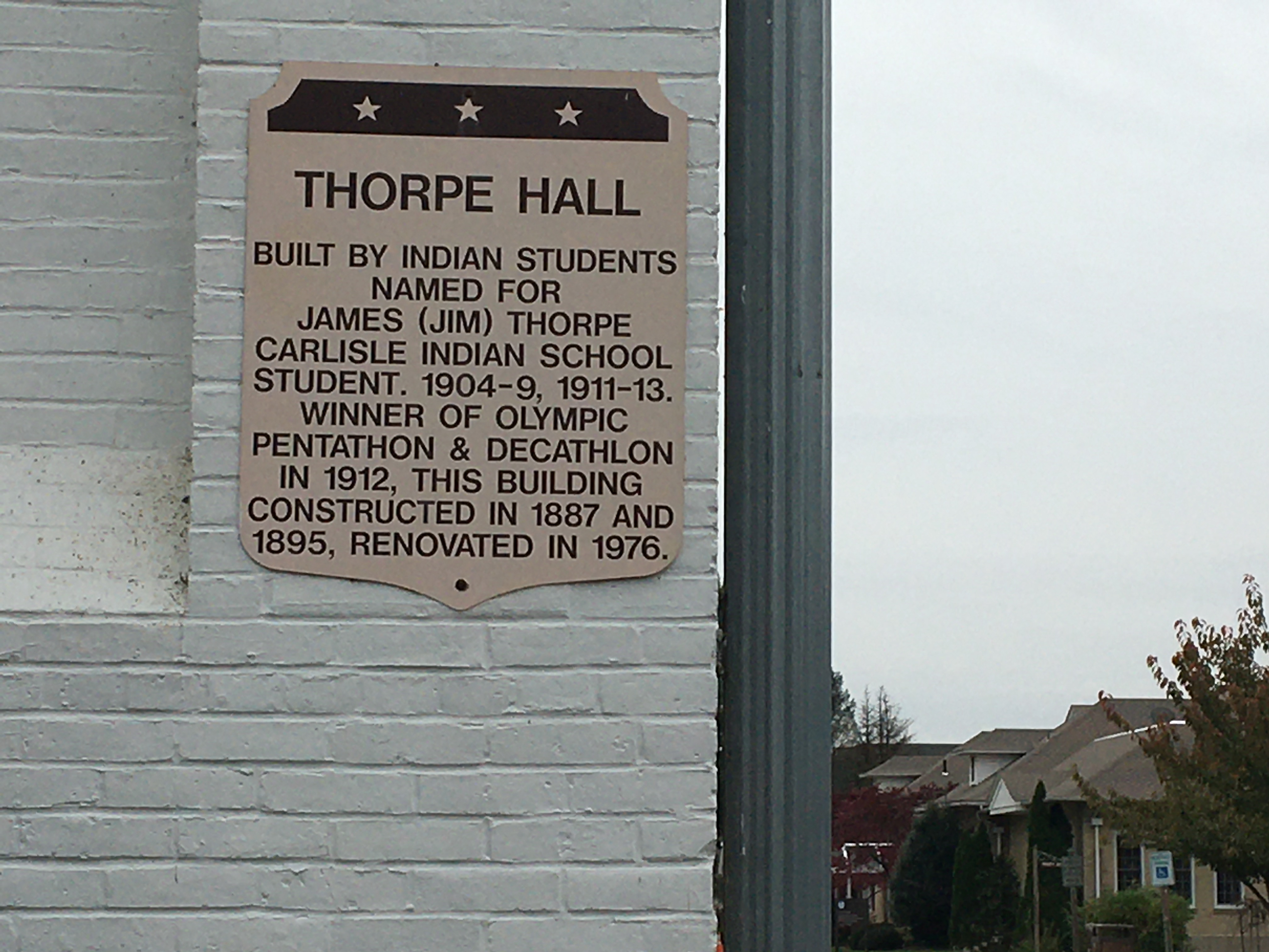 Historical marker on the building.
