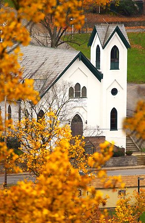 Berkeley Springs Presbyterian Church with gabled roofs and fenestration typical of the Gothic Revival style. Courtesy of Travel Berkeley Springs.