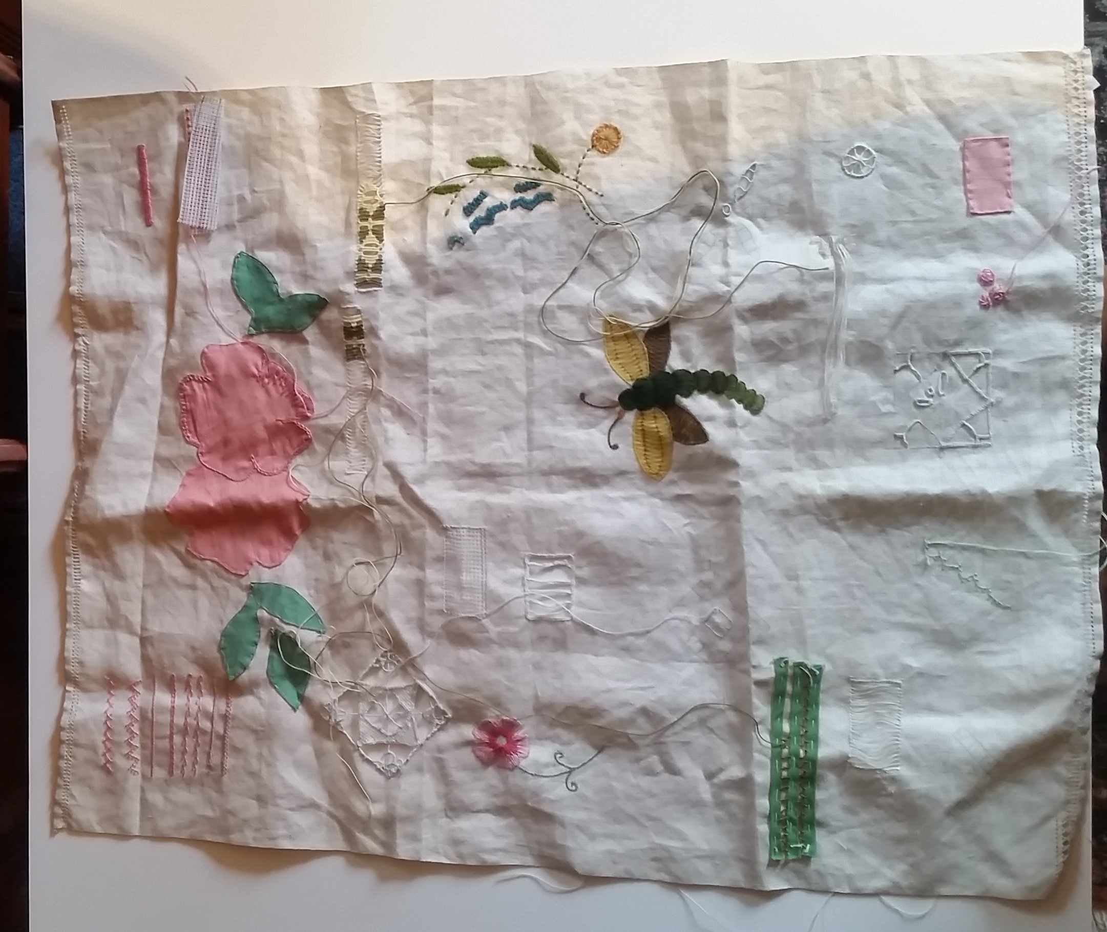 This sampler was found in a sewing basket belonging to Esther Sybilla Hefty, 1883-1963. A sampler was used by young girls or women to practice stitching techniques, usually before she was married. Patterns were stenciled onto the fabric as a guide.