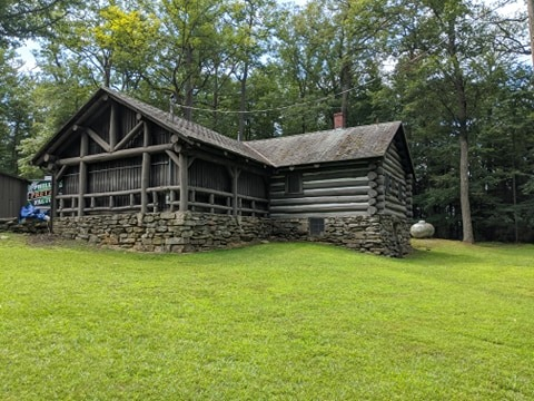 Overlook Trading Post from the rear. Note the different construction style of the original cabin and the original picnic enclosure surrounding the newer solid walls of the front section