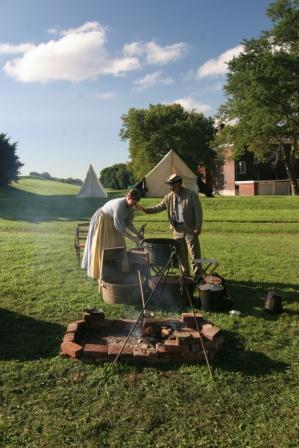 Civil War reenactors prepare for a meal on Governors Island.