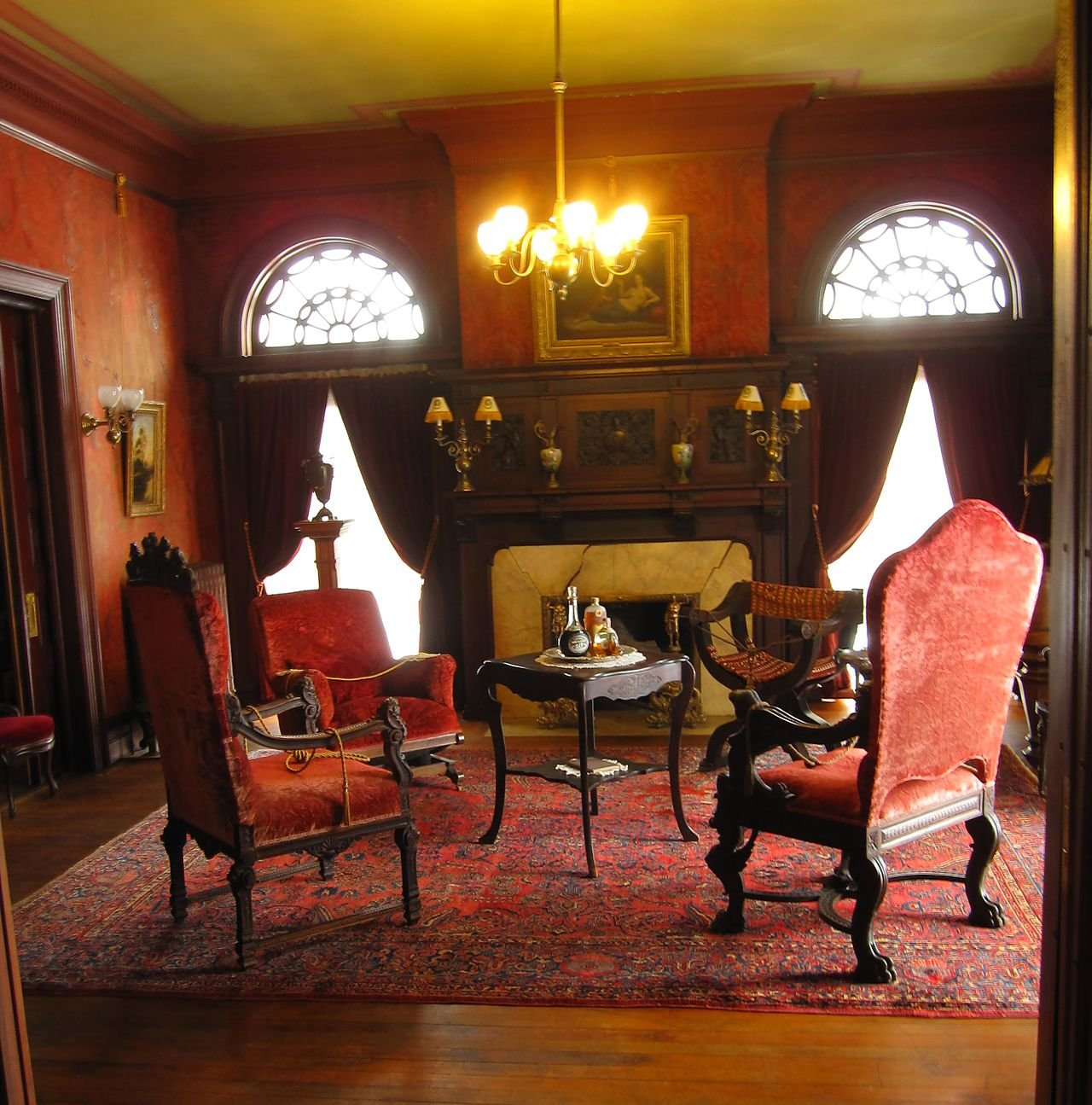 The mansion features many large rooms and antique furnishings.