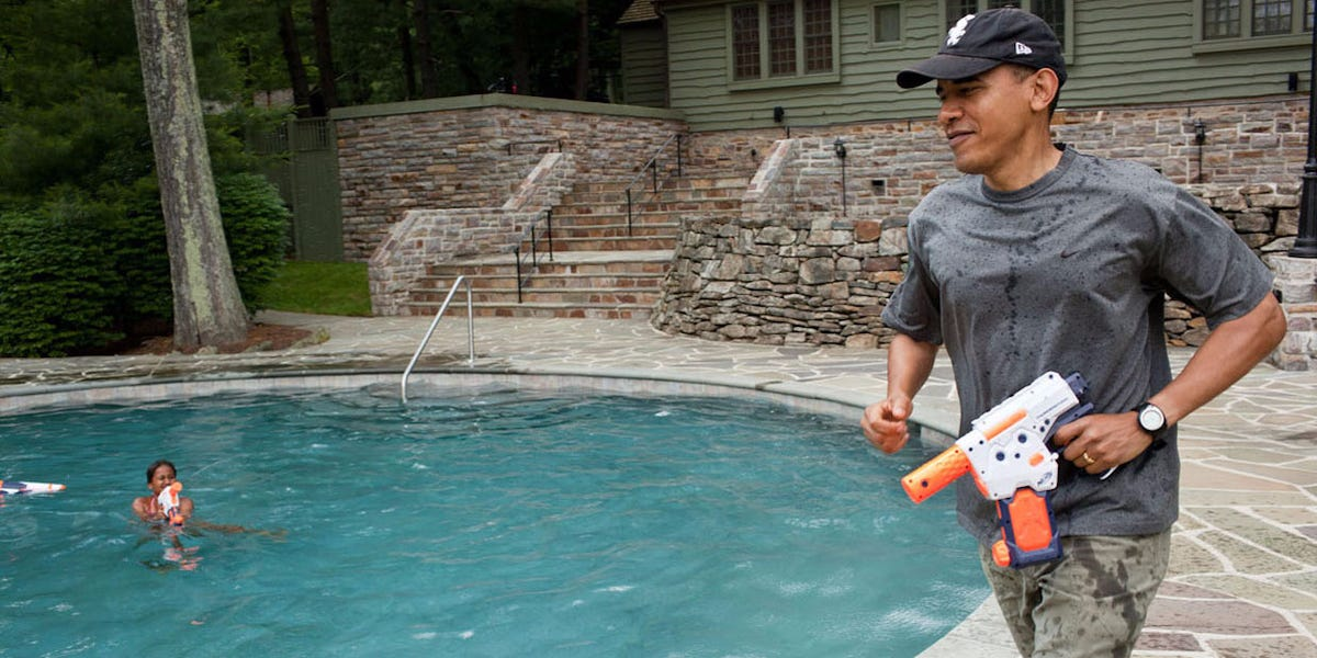 President Obama playing at the pool with his daughter, 2011