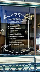 Sign listing the current tenants of the Vance Hotel Building, now an office/retail complex