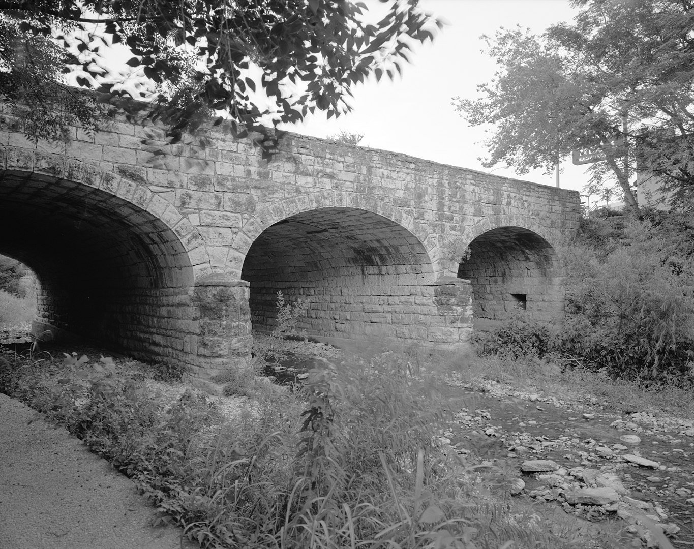 1968 photo of the historic West Sixth Street Bridge at Shoal Creek in Austin, Texas.