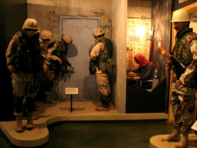 This exhibit depicts soldiers breaching a door as a team.