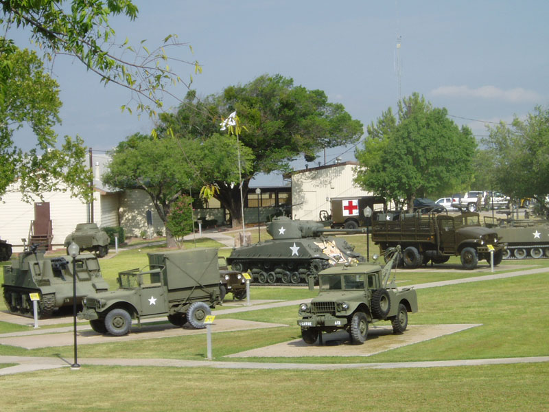 The museum is surrounded by acres of armored vehicles that include tanks and helicopters.
