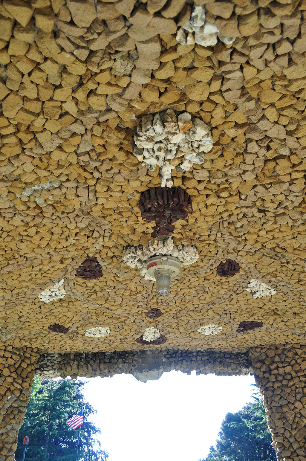 The ceiling of the bandstand features a decorative stone mosaic.