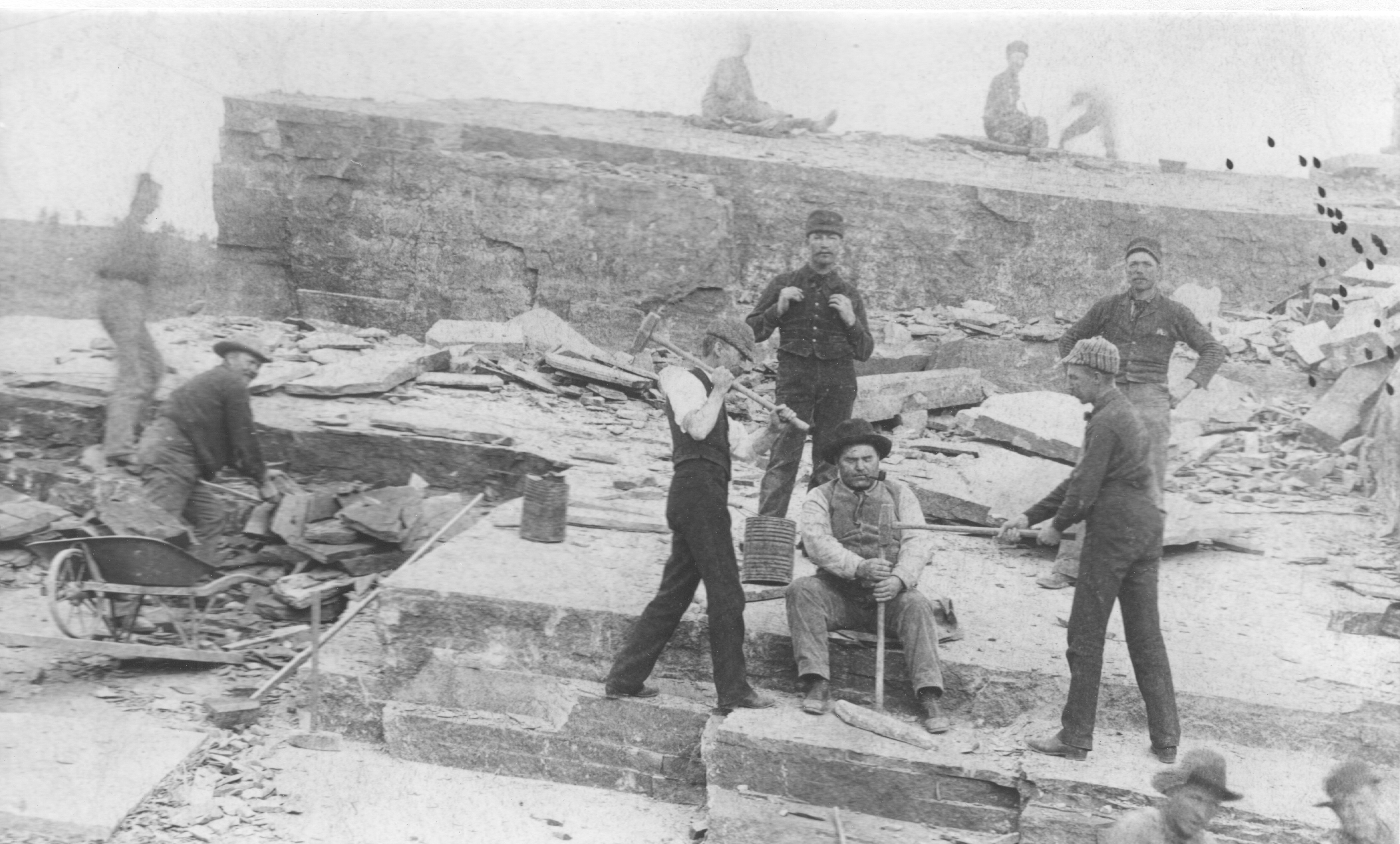 Historic photo of quarry workers using a drill to break apart sandstone. Photo courtesy of the Lyons Redstone Museum.