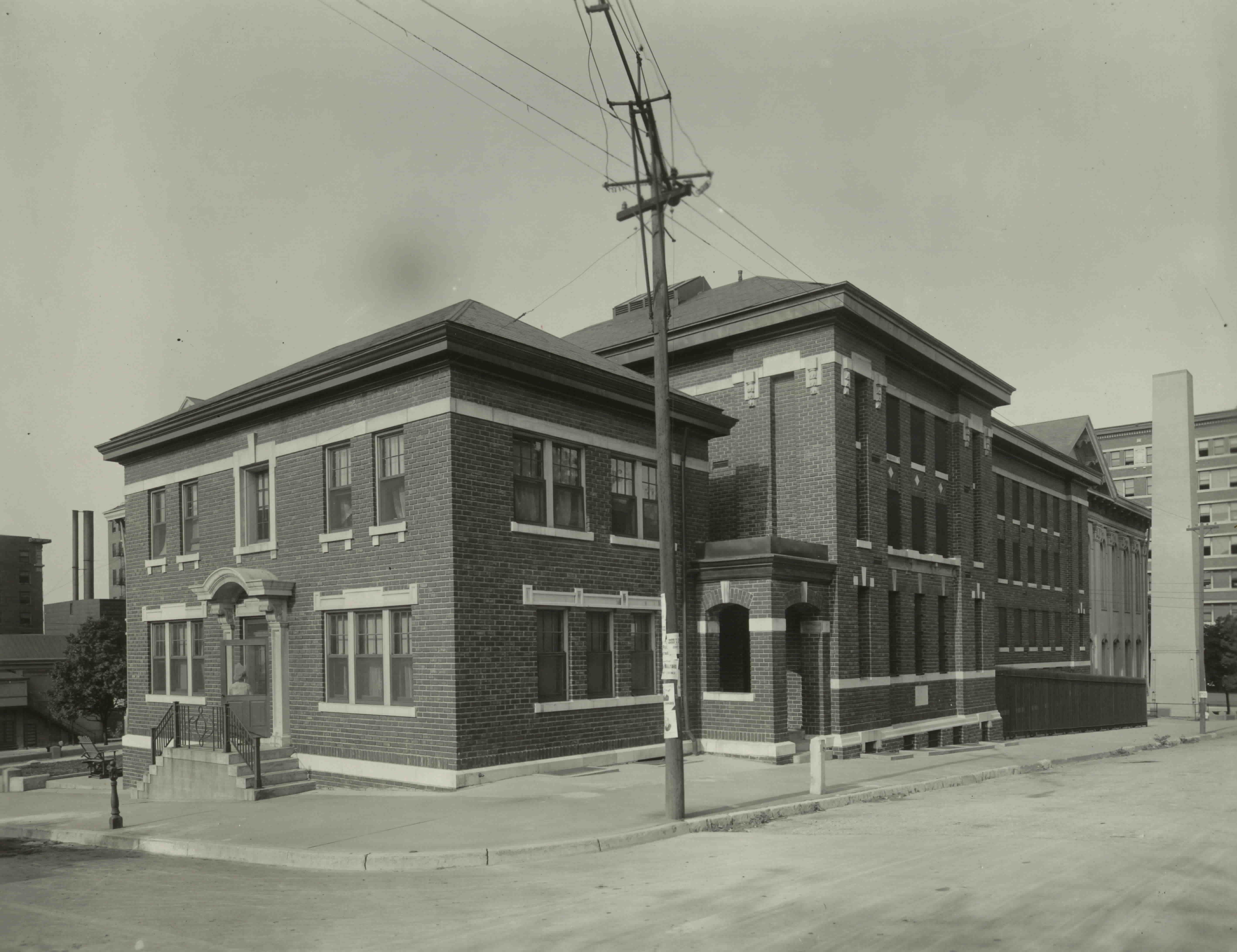 Buchanan County Jail, 322 N. Fifth Street,  5th & Faraon, 1909.  Designed by Eckel & Boschen.  Constructed in 1909. Front and north side looking west down Faraon Street. Image provided by the St. Joseph Museums, Inc.