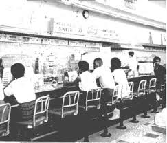 The St. Augustine Four sitting at the counter of Woolworth's. The site is on the National Register of Historic Places.