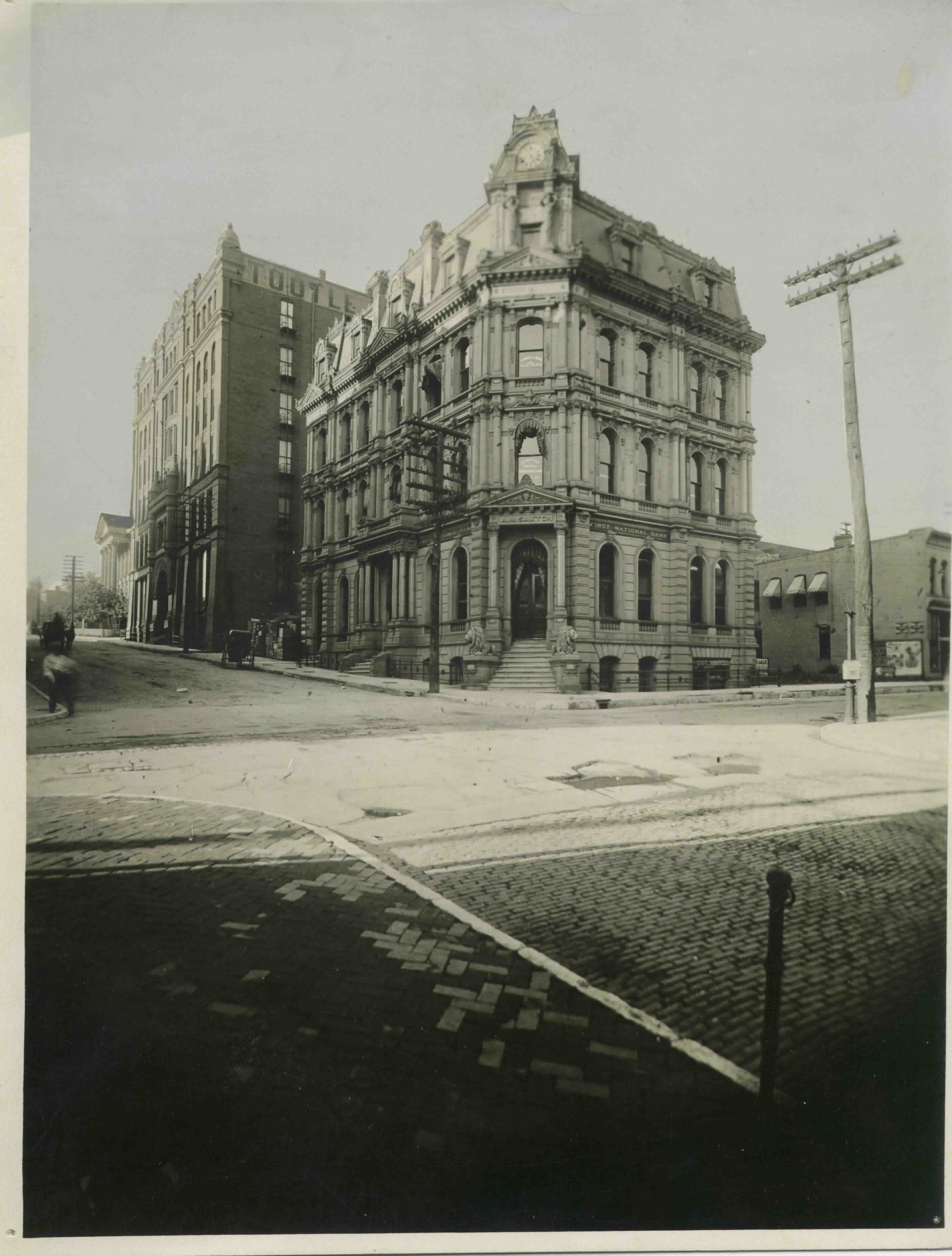 Northeast corner of Fourth and Francis Streets depicting the Saxton National Bank Building.