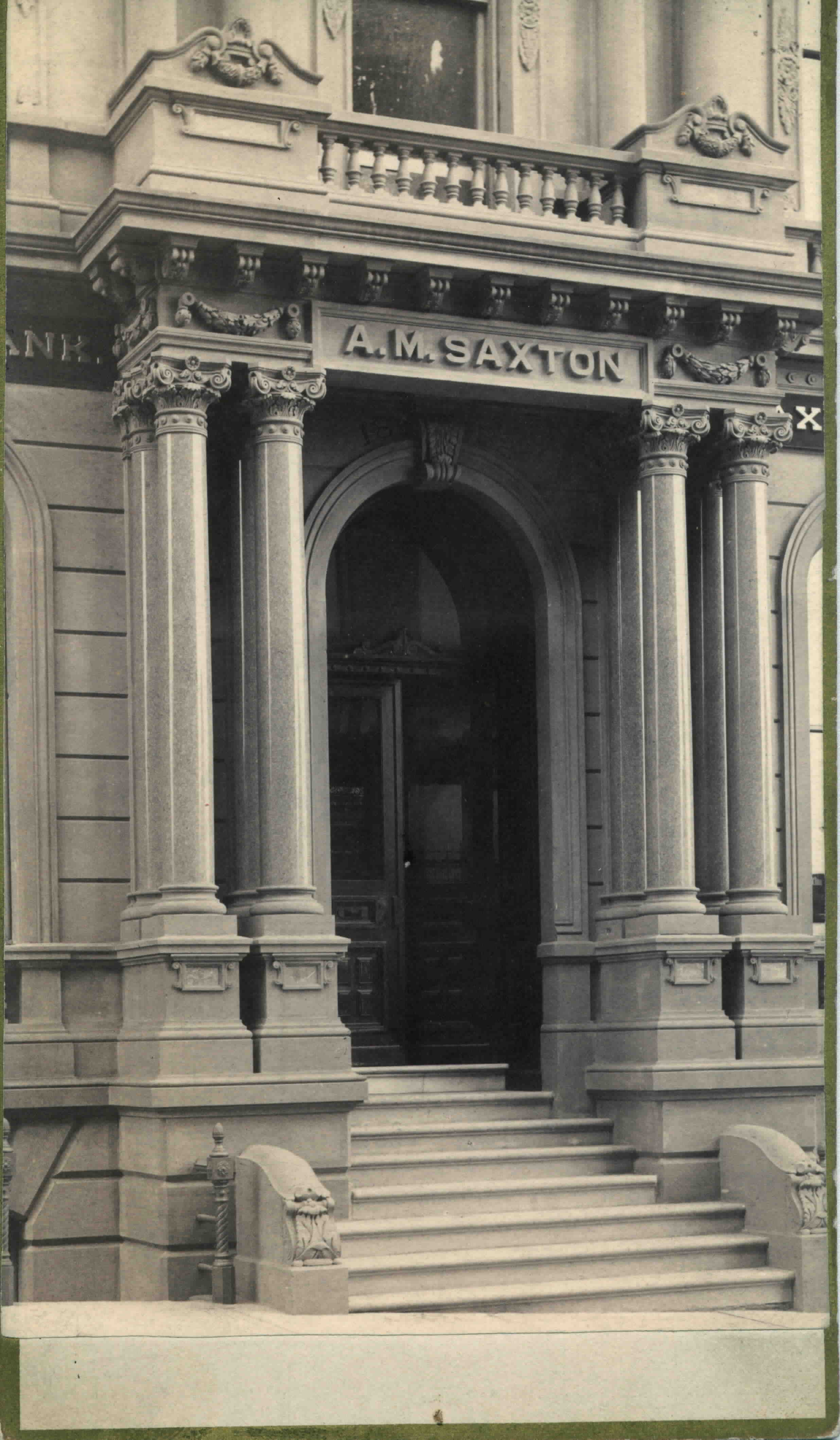Close up of the Saxton National Bank entrance with A.M. Saxton engraved above the door.