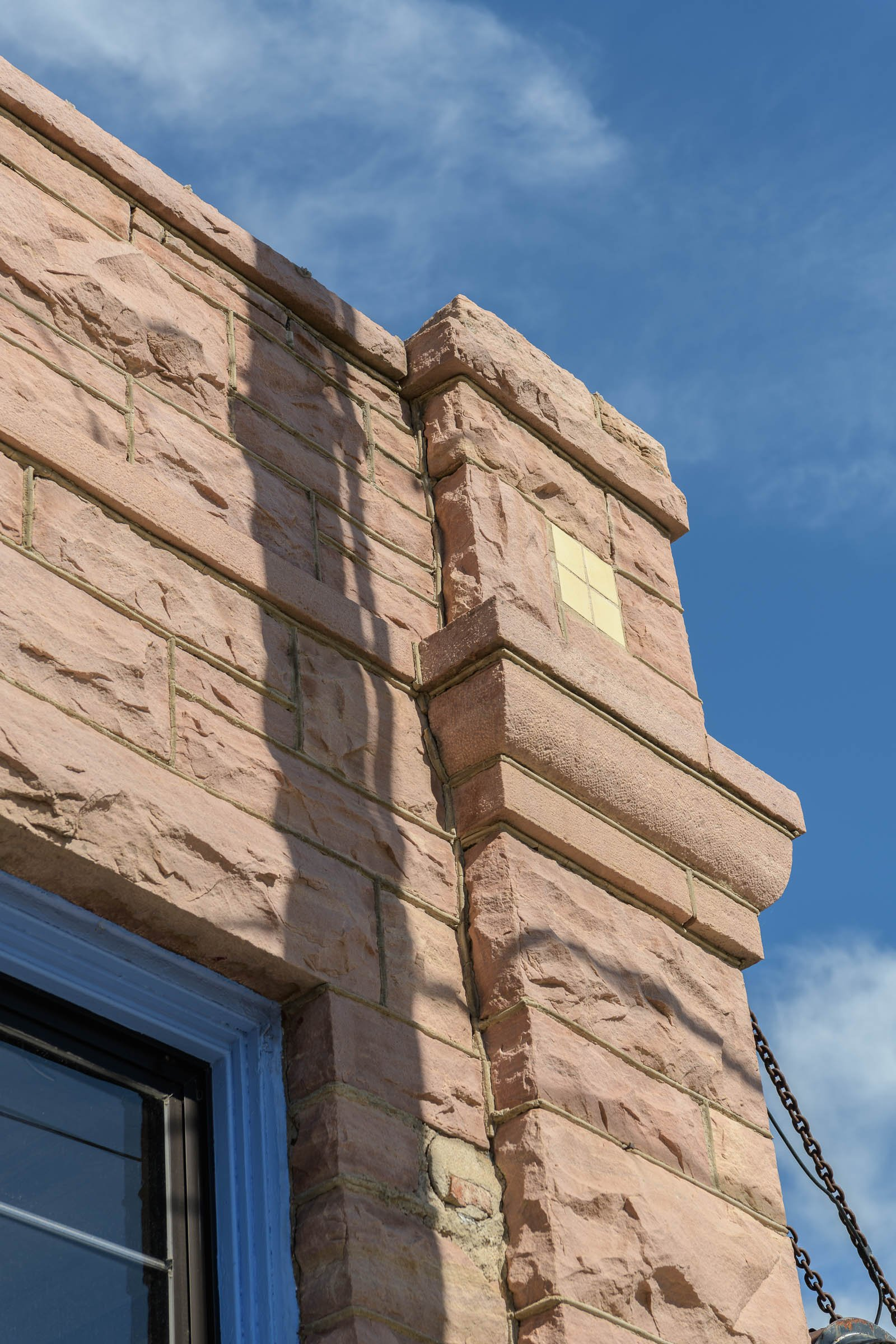 One of the corbels on the corner of the Turner-Stevens Building. 