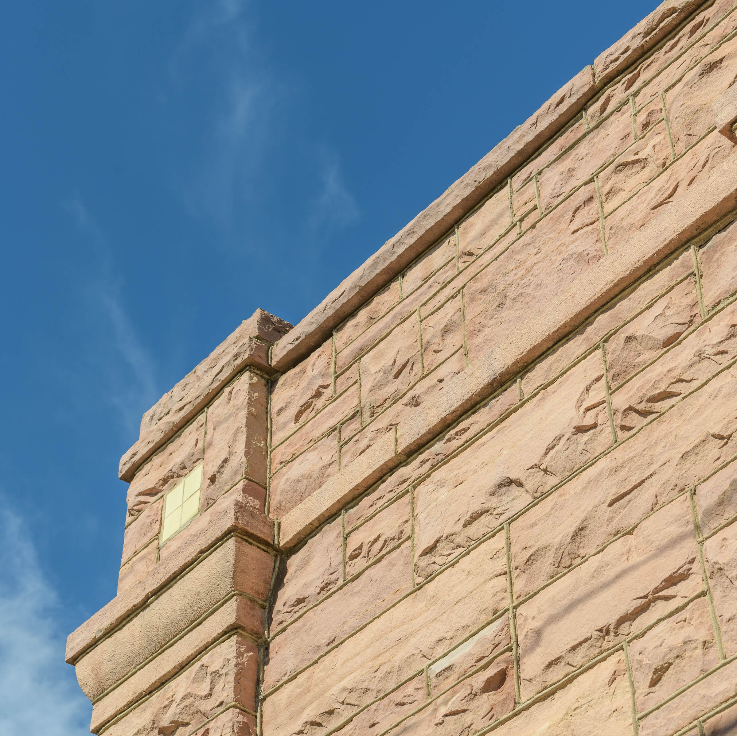 The simple cornice along the roofline of the Turner-Stevens Building. 